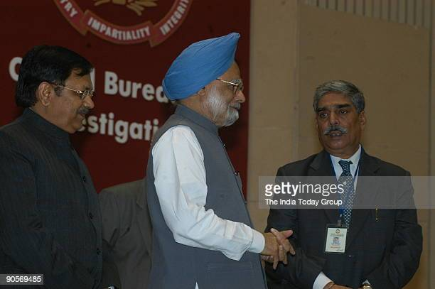 Manmohan Singh Prime Minister of India with Vijay Shankar Director of the Central Bureau of Investigation and Suresh Pachouri Minister of State for...
