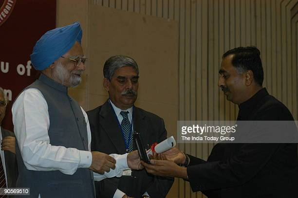 Manmohan Singh Prime Minister of India with Vijay Shankar Director of the Central Bureau of Investigation at State anti corruption Bureau meeting...