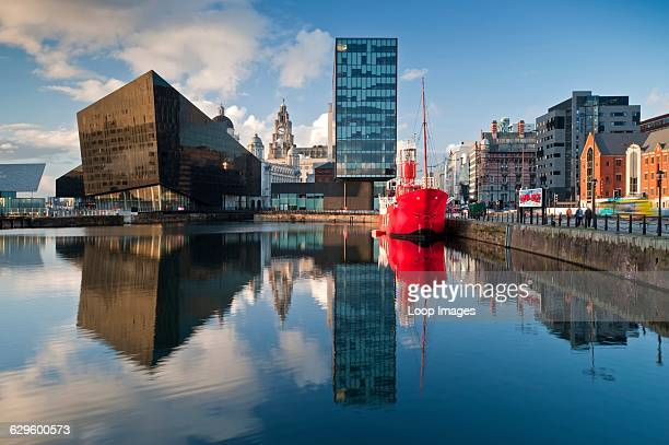 Mann Island apartments with Liver Building and lightship and waterfront buildings viewed across Canning Dock, Liverpool, England.