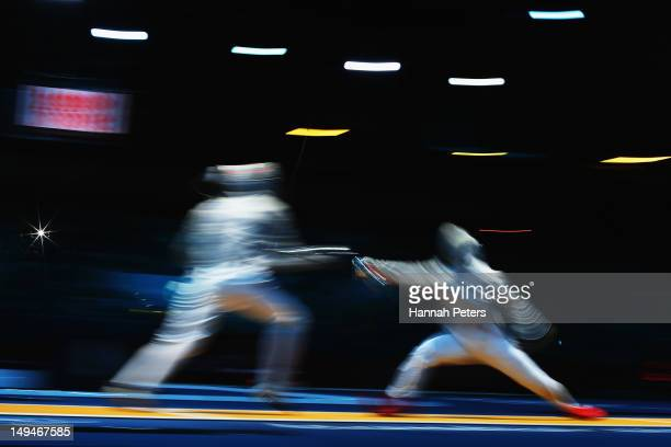 Mannad Zeid of Egypt and Peng Kean Yu of Malaysia compete in the Men's Sabre Individual Fencing round of 64 match on Day 2 of the London 2012 Olympic...