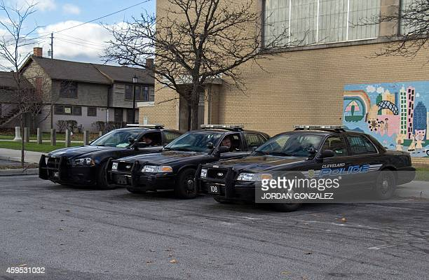 Manned police cars are parked near Cudell Commons Park in Cleveland Ohio November 24 2014 where a memorial was set up for Tamir Rice a 12yearold boy...