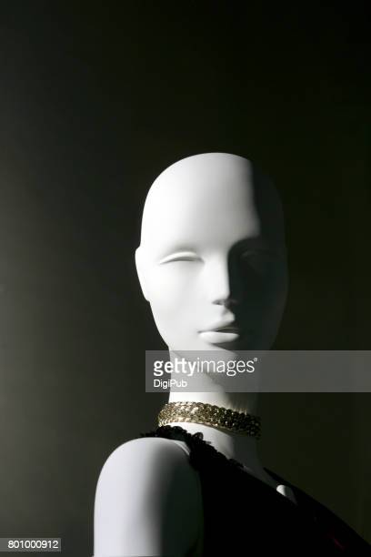Mannequin against dark background