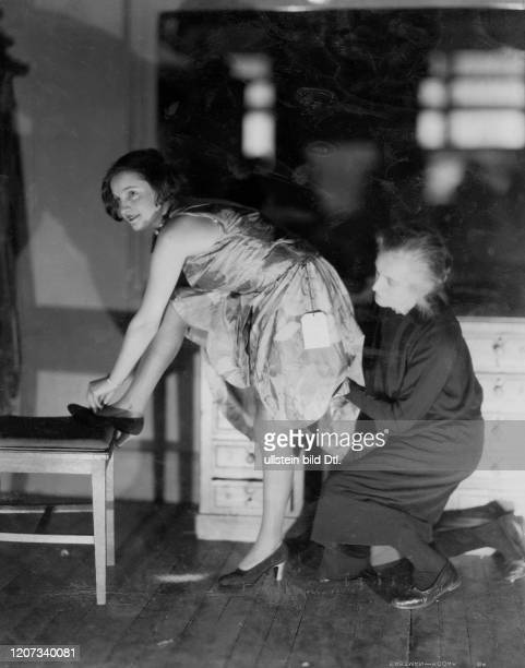Mannequin and wardrobe woman changing clothes Vintage property of ullstein bild Published in Uhu 22