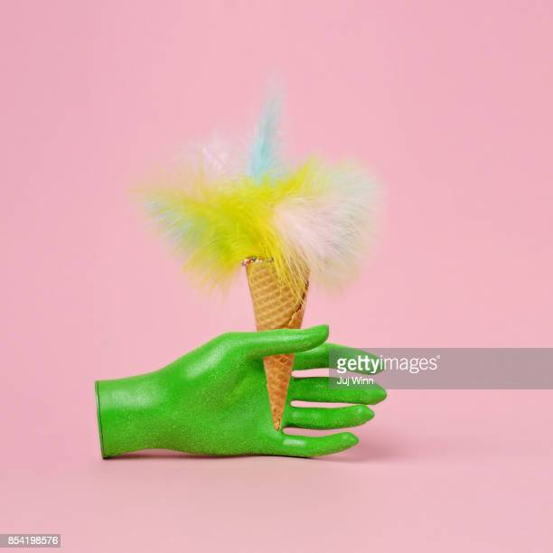 Mannequin hand holding feathered ice cream cone