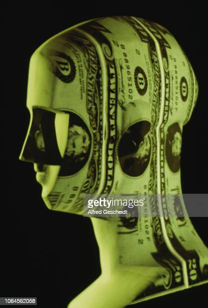 A mannequin head with an image of 20 American dollars banknotes superimposed over it US 1983