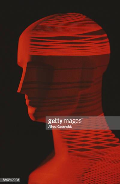 A mannequin head with an image of a red computerised grid superimposed over it 1985