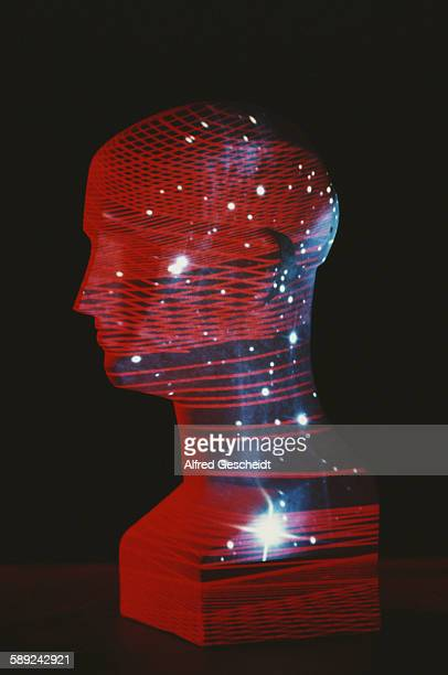 A mannequin head with an image of stars and a computerised grid superimposed over it 1985