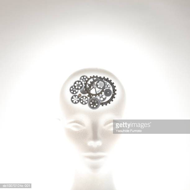 Mannequin head with gear wheels as brain