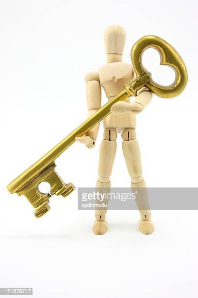 Mannequin holding gold key