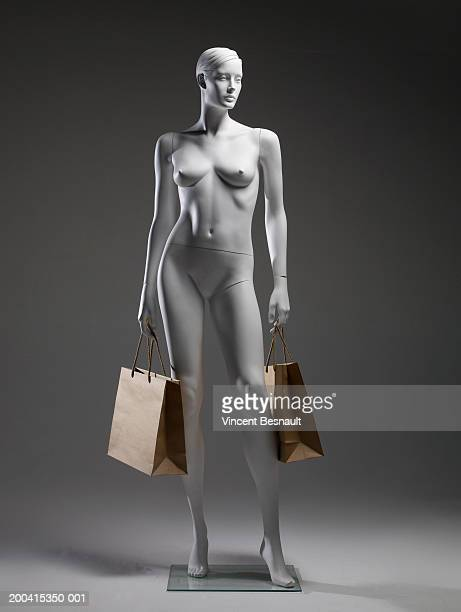 Mannequin holding shopping bags