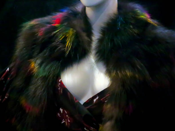 Mannequin in colorfully dyed fur coat showing cleavage