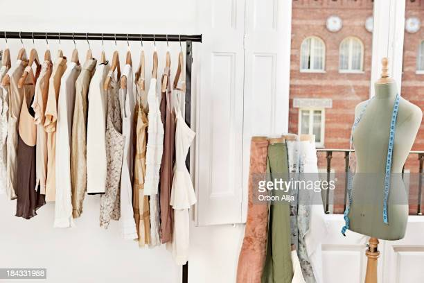 mannequin in fashion designer's studio - rack stock pictures, royalty-free photos & images