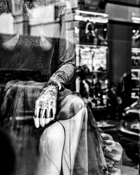 Mannequin In Store Seen Through Glass