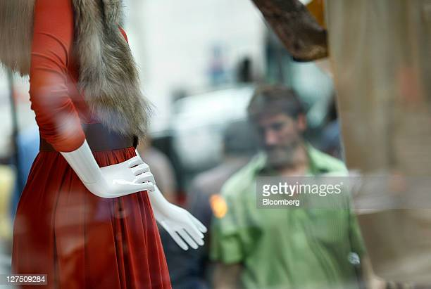 A mannequin is displayed in the window of a Hennes Mauritz AB store in New York US on Tuesday Sept 27 2011 The Bloomberg via Getty Images Consumer...