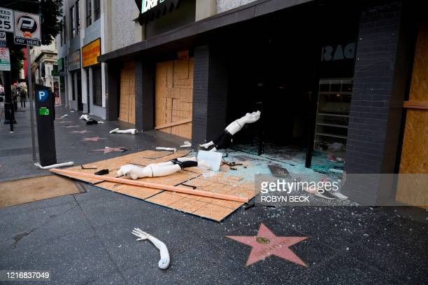 A mannequin is seen on the street after a store was broken into in Hollywood California on June 1 after a third day of protests and looting in...