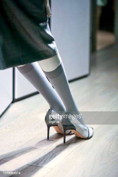 mannequin legs and feet wearing gray stockings and canvas high heels - パンティストッキング ストックフォトと画像