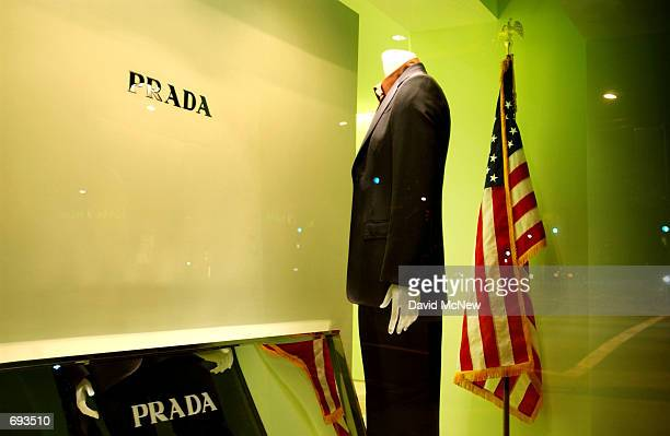 A mannequin looks like it is standing at attention before the name of the Prada store on Rodeo Drive with its back to the flag January 8 in Beverly...
