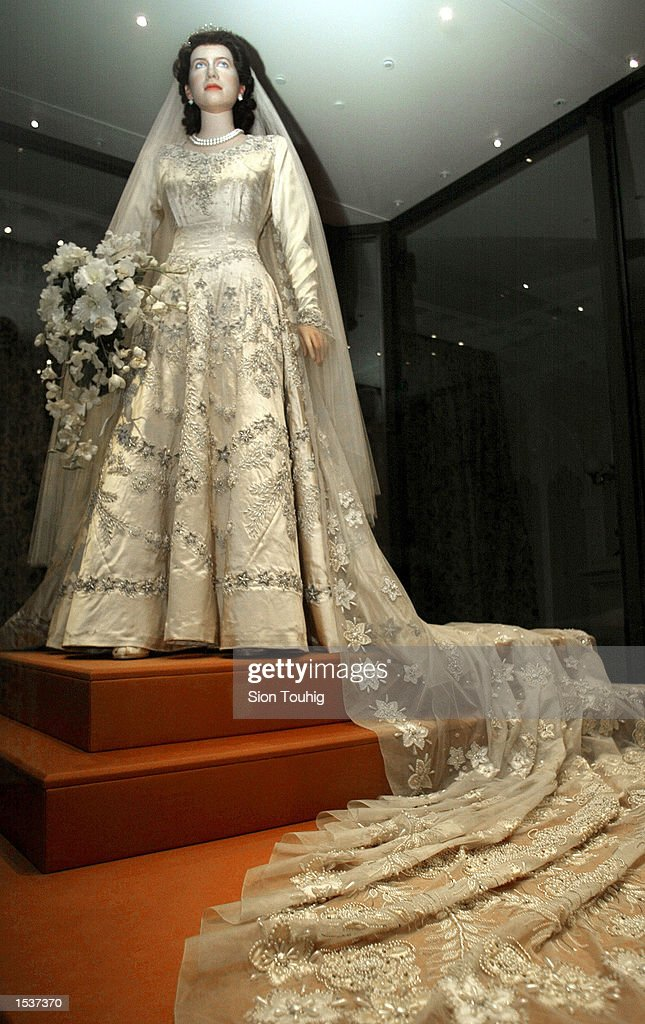 A mannequin of Britain's Queen Elizabeth II wears her wedding dress April 30, 2002 at the launch of the exhibition 'A Century of Queens'' Wedding Dresses 1840 - 1947' at Kensington Palace in London. The dresses are on display for the first time as part of the Queen's Golden Jubilee celebrations. Queen Elizabeth, who married Philip Mountbatten in 1947, wore a satin dress designed by couturier Norman Hartnell with a silk veil and diamond tiara.