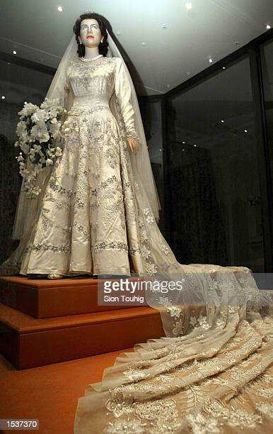 A mannequin of Britain's Queen Elizabeth II wears her wedding dress April 30 2002 at the launch of the exhibition A Century of Queens'' Wedding...