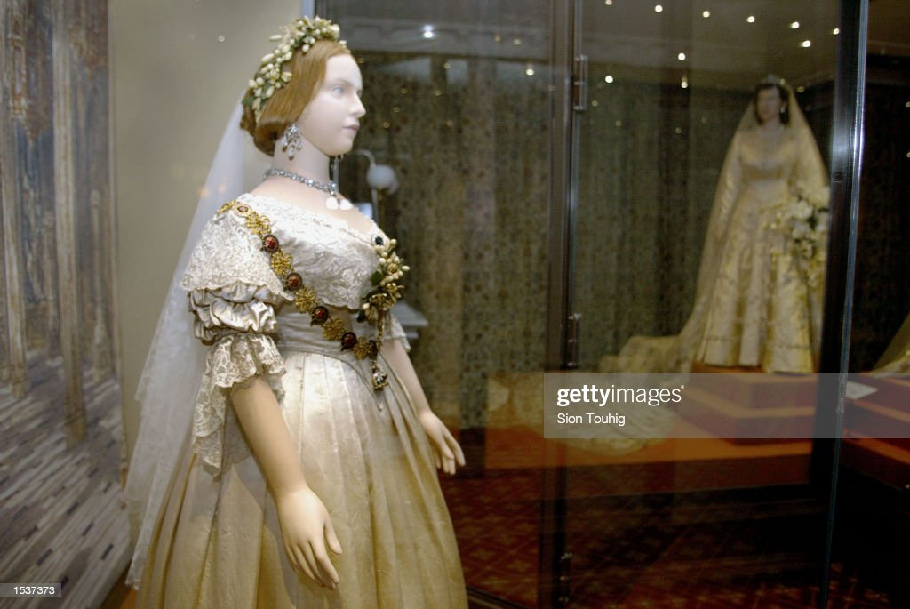 A Mannequin Of Britain S Queen Victoria Wearing Her Wedding Dress Stands In Front
