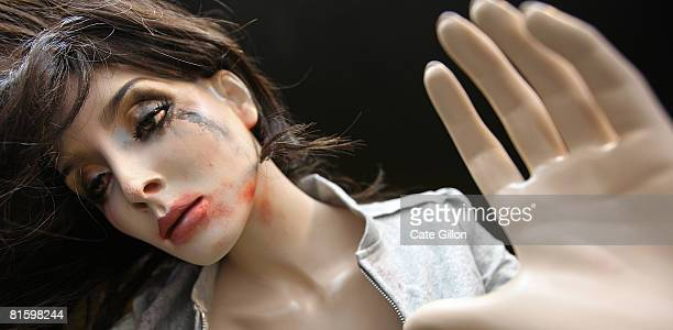 A mannequin posed as a drunken disheveled young woman after excessive drinking in part of an unlit window display by the Home Office on June 17 2008...