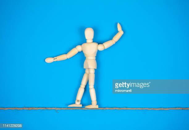 mannequin walking on a line - artist's model stock pictures, royalty-free photos & images