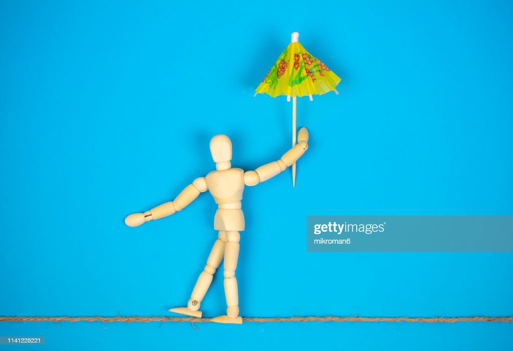 Mannequin walking on a line : Stock Photo