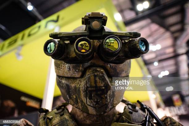 A mannequin wears a Kinetic Operations Suit featuring Quad Optic goggles on the Vision stand inside the ExCeL centre in London on September 15 during...