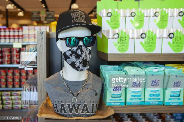 A mannequin wears a protective mask at a market in Wailea Hawaii US on Sunday April 26 2020 Tourism makes up onefifth of Hawaii's economy gross...