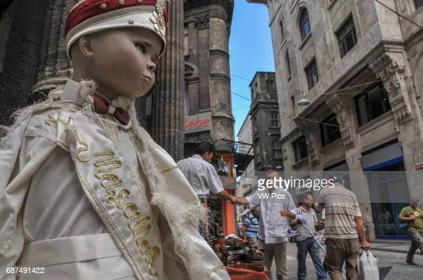A mannequin with a boy's ceremonial 'SÙnnet' costume SÙnnet is the islamic circumcision ritual which in Turkey commonly takes place when boys are...