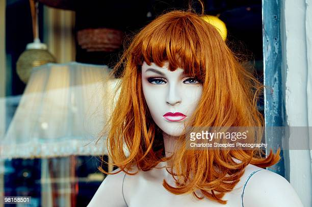 Mannequin with a red wig