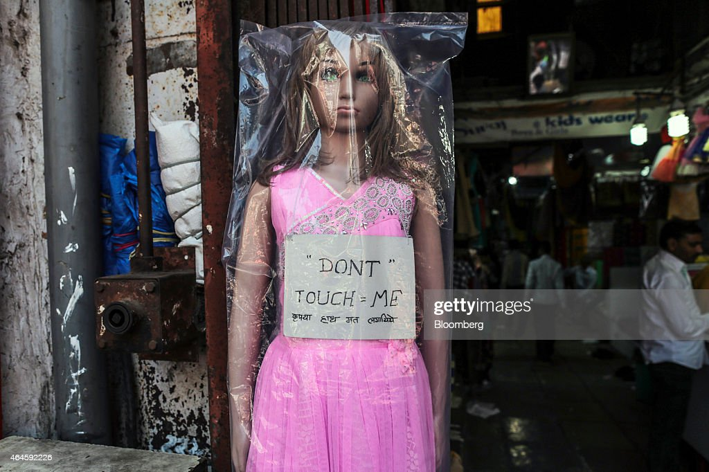 A mannequin with a sign reading 'Don't touch me' is displayed outside a store in Mangaldas Market in Mumbai, India, on Thursday, Feb. 26, 2015. India's Finance Minister Arun Jaitley will present this year's budget on February 28. Speculation that Prime Minister Narendra Modi's policies will boost economic growth has propelled India's Sensex to the world's third-biggest gain among major markets during the past 12 months. Photographer: Dhiraj Singh/Bloomberg via Getty Images
