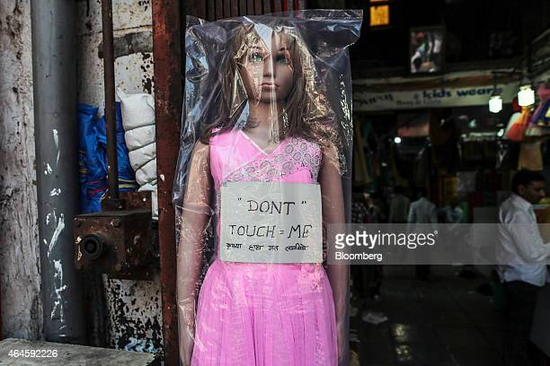 A mannequin with a sign reading 'Don't touch me' is displayed outside a store in Mangaldas Market in Mumbai India on Thursday Feb 26 2015 India's...