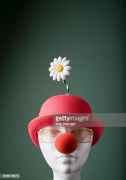 mannequin with hat and clown nose - clown's nose stock photos and pictures