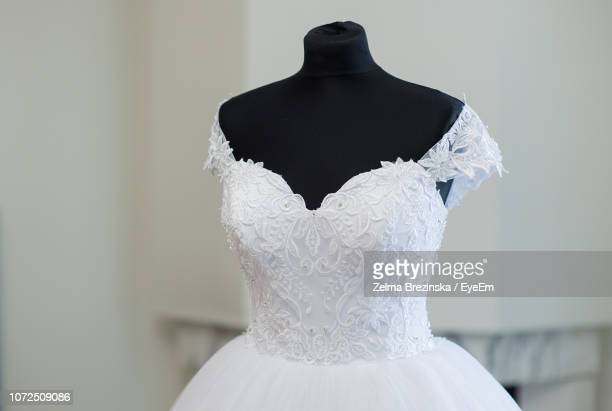 mannequin with wedding dress against wall - lace dress stock pictures, royalty-free photos & images