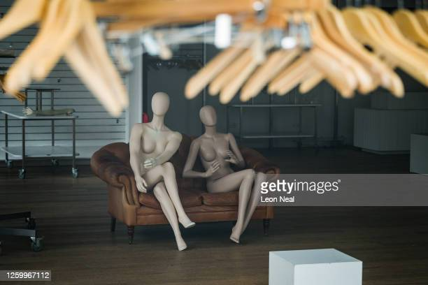 Mannequins and empty clothes rails are seen in a permanently closed store on July 27, 2020 in London, England. A recent report from the UK's Office...