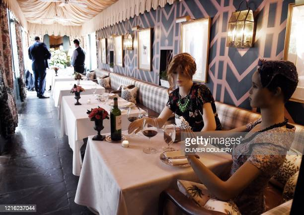 Mannequins are placed at a table to help with social distancing at The Inn at Little Washington one of the countrys most renowned restaurants on the...