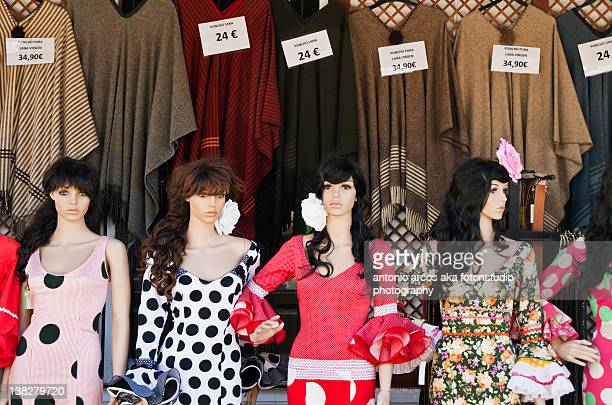 Mannequins at window of shop