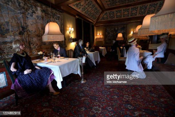 Mannequins costumed in 1940's era clothing are seated in the dining area of the Inn at Little Washington, a Michelin three star restaurant in the...