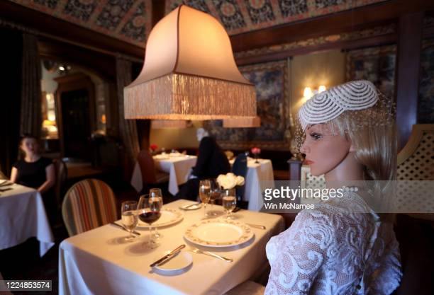 Mannequins costumed in 1940's era clothing are seated in the dining area of the Inn at Little Washington a Michelin three star restaurant in the...