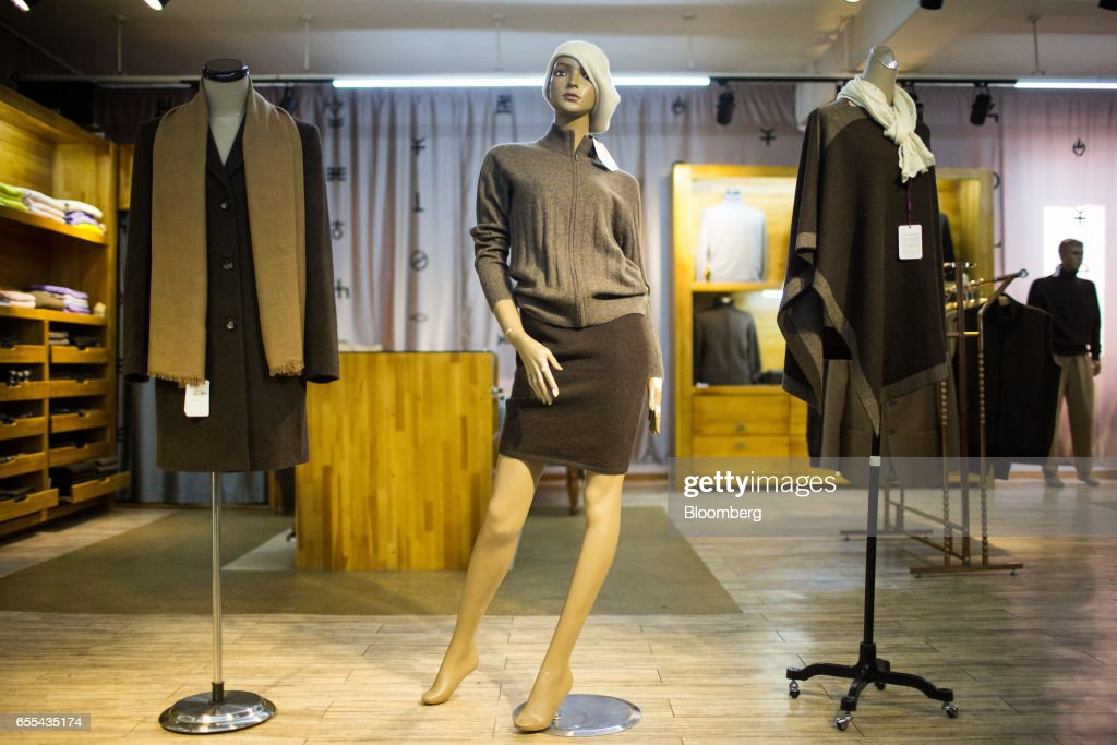 Mannequins display cashmere clothing and other knitted products at a Bodios Co. store in Ulaanbaatar, Mongolia, on Wednesday, March 15, 2017. Mongolia's gross domestic product is expected to expand eight percent by 2019, and then grown at around five to six percent after that, International Monetary Fund (IMF) Mission Chief for Mongolia, Koshy Mathai, said in an interview last month with Bloomberg Mongolia TV. Photographer: Taylor Weidman/Bloomberg via Getty Images