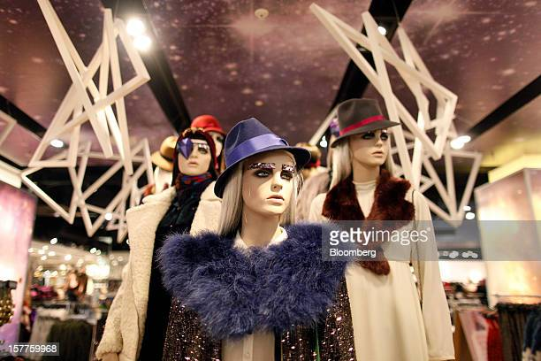 Mannequins display women's clothes and hats inside a Topshop store owned by Arcadia Group Ltd on Oxford Street in London UK on Thursday Dec 6 2012...