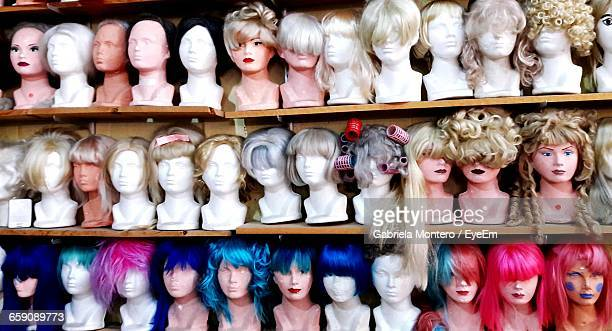 Mannequins Displayed On Shelves At Store
