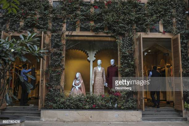 Mannequins displaying wedding dresses stand outside a clothing store in Mumbai India on Friday Dec 15 2017 India's inflation surged past the central...