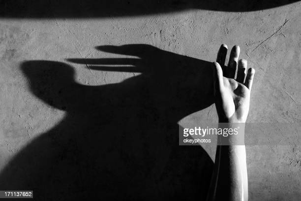 Mannequin's hand and shadow.