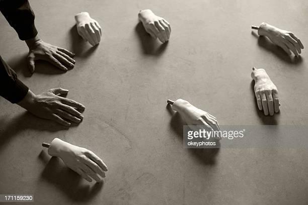 Mannequin's hands on the floor.