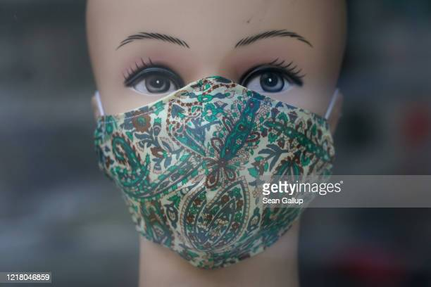 Mannequin's head displays a home-made protective face mask in the window of a locksmith's during the novel coronavirus crisis on April 10, 2020 in...