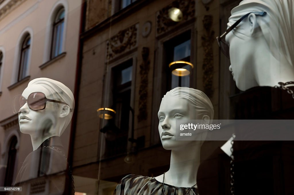 Mannequins in the shop window : Stock Photo