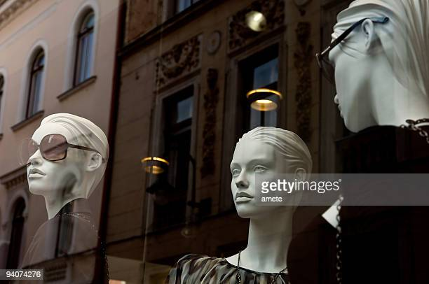 mannequins in the shop window - high fashion stock pictures, royalty-free photos & images