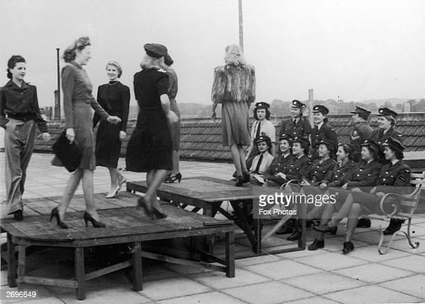 Mannequins parading before service women are showing the latest utility fashions and the '731', an artificial silk-plated stocking called 'Mr...